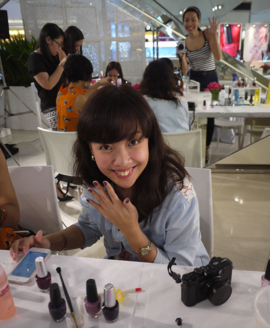 This is at the OPI Nail Art Event—practicing our skills for the Sparkle Sessions. Can you spot the hyper photobomber?