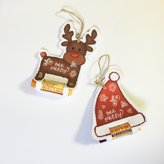 Here's a closer look! The reindeer is the Burt's Bees Nourishing Lip Balm with Mango Butter and the santa hat is P325 each.