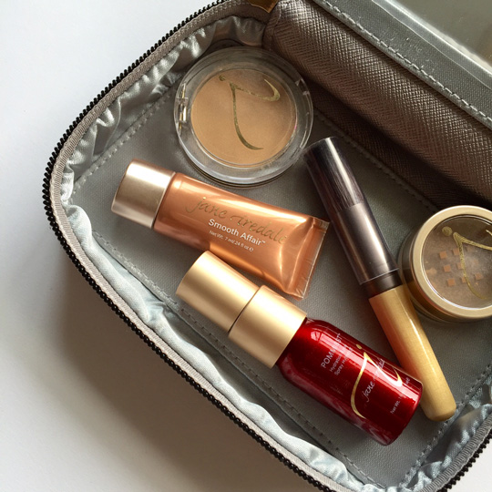 The makeup bag is chic and I like that the brush comes with a protector, so it doesn't get dirty. And there's plenty of space for your lipstick, eyeliner, and blush, too!