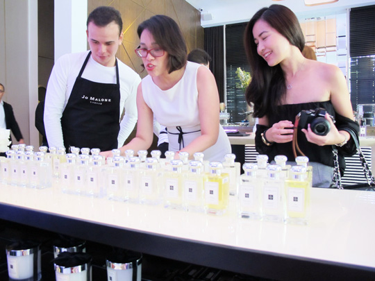 Frances of Topaz Mommy and Angela of Lush Angel checking out the fragrance bar to find their scents.