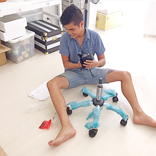 """I was hitting my """"decorating"""" limit, so I called in a little help! Say hi to my not-so-little brother, RG :) He was kind enough to assemble my office chair for me."""