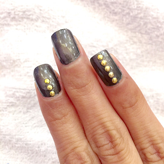 And voilà—easy nail art! Use three circles if you want it a bit discreet or you can line them across your entire nail to channel your inner Kylie Jenner.