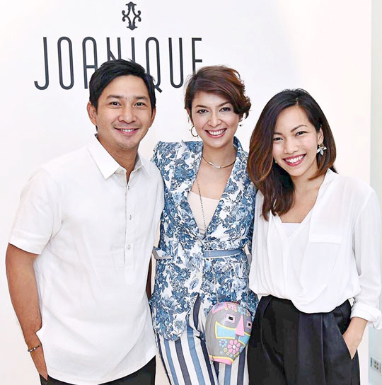 That's my Kuya Nikki and his wife, Malou. She's the designer behind Joanique—a homegrown accessories brand.